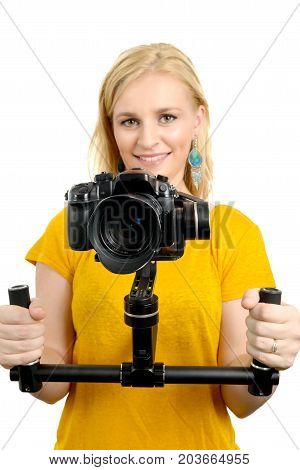 young woman videographer using steady cam on white