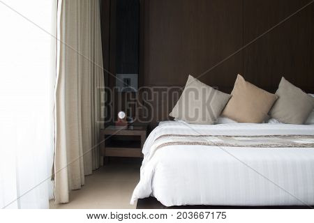 Decoration of the bedroom in earth tone.