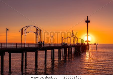 Brighton Beach jetty with people at sunset South Australia