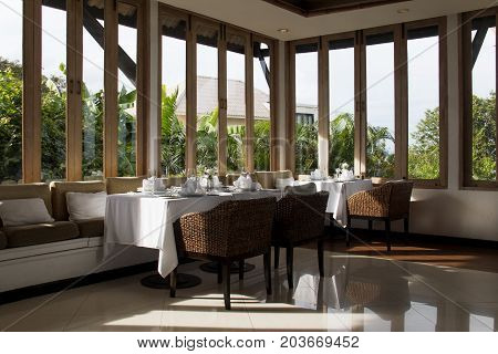 Dining table setting in restaurant. Restaurant bright with sunlight.