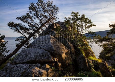 Beautiful nature landscape picture of Whytecliff Park during a sunny summer evening. Picture taken in Horseshoe Bay West Vancouver BC Canada.