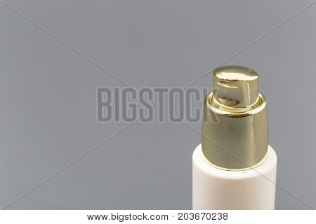 Mini Bottle Sprayer On Gray Background In