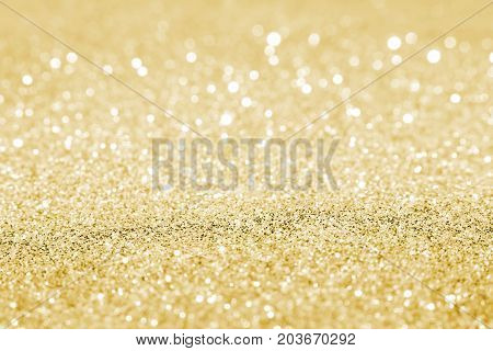 beautiful gold sequins on the vagueness of the background