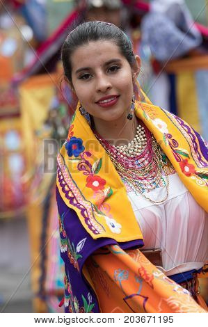 June 17 2017 Pujili Ecuador: portrait of a quechua young woman in traditional clothing during Corpus Christi parade is impressive