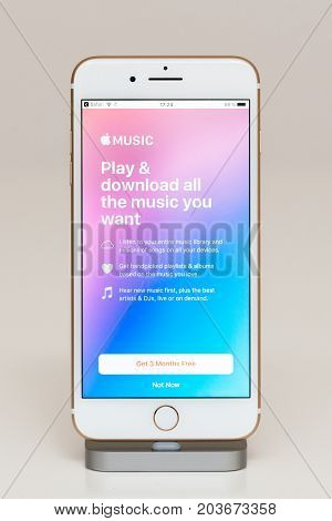 PARIS FRANCE - SEP 26 2016: New Apple iPhone 7 Plus in docking station after unboxing and testing by installing and running the Music - play and download all the music you want