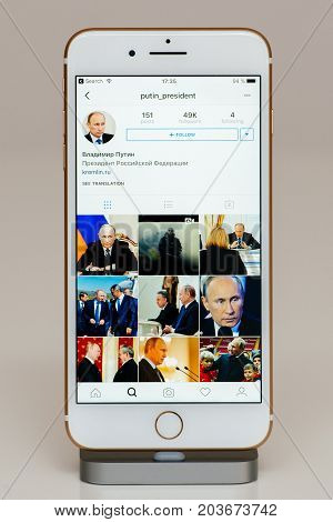 PARIS FRANCE - SEP 26 2016: New Apple iPhone 7 Plus in docking station after unboxing and testing by installing and running the app application software Vladimir Putin Instagram Account