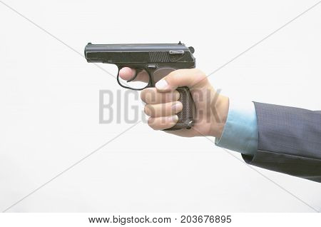 Man in suit hand with gun isolated. Killer.