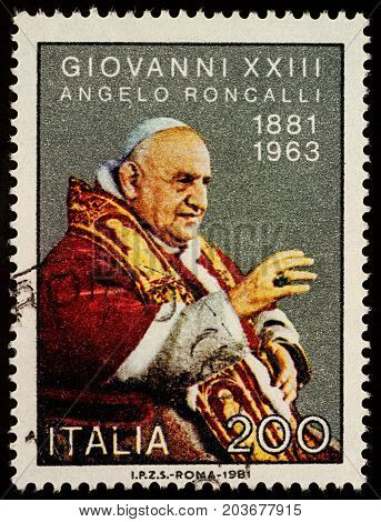 Moscow Russia - September 11 2017: A stamp printed in Italy shows portrait of Pope John XXIII dedicated to the 100th Anniversary of the Birth of Pope John XXIII circa 1981
