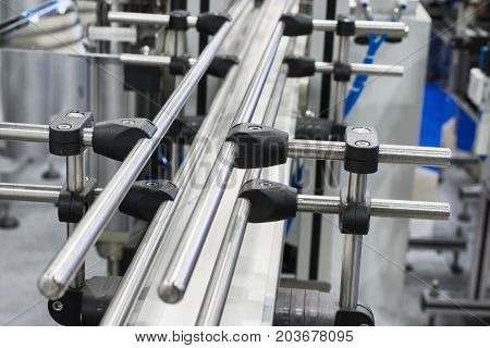 Steel conveyor for transportation of glass bottles. Belt conveyors.
