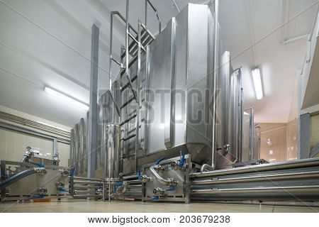 Rectangular steel tank. The system of storage and pumping of liquid.