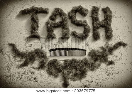 Barbers sign for male grooming made from mens facial hair with a comb. Old style with the word tash short for moustashe. Celebrate movember
