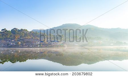 Landscape photo of morning with white fog over lake at Ban Rak Thai village, Maehongson or Mae Hong Son Thailand.