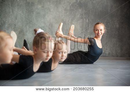 Girls Stretch Before A Ballet