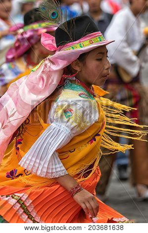 June 17 2017 Pujili Ecuador: female dancer dressed in traditional clothing in motion at the Corpus Christi annual parade