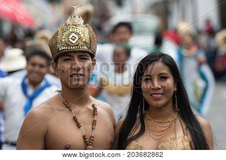 June 17 2017 Pujili Ecuador: male and female dancers closeup from the Amazon area at the Corpus Christi festival