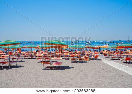 umrellas on the beach of Positano - famous old italian resort, Italy