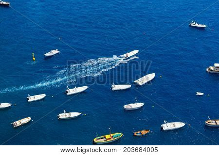Tyrrhenian Sea waters with leasure boats, aerial view , Amalfi coast, Italy