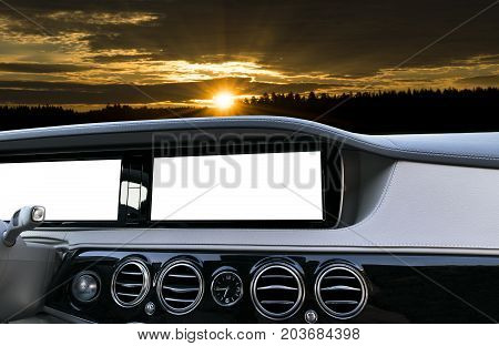 White Screen system display for GPS Navigation and Multimedia as automotive technology in car. white copy space of touch screen. Modern car dashboard empty space for text. Blank empty white screen. Outdoor concept over the sunset.