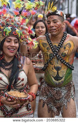 June 17 2017 Pujili Ecuador: couple from the Amazon area participating at the Corpus Christi festival
