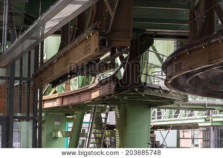 The supporting framework of the Wuppertaler suspension railway consists of a steel framework with inclined supports and suspended steel bridges so-called Rieppelträger.