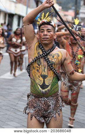 June 17 2017 Pujili Ecuador: male dancer from he Amazon area at the Corpus Christi annual parade