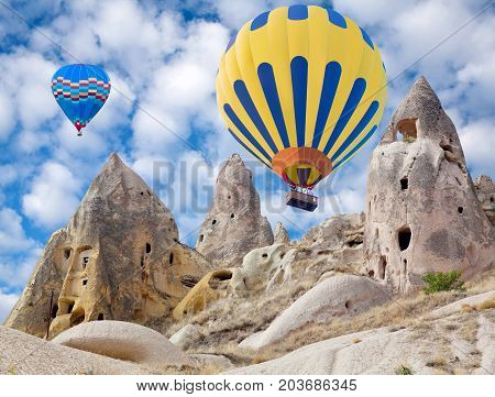 Colorful hot air balloons flying over the Pigeon valley in Cappadocia, Anatolia, Turkey