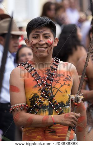 June 17 2017 Pujili Ecuador: man with painted upper body at the annual parade of Corpus Christi in the high altitude town