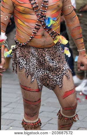 June 17 2017 Pujili Ecuador: man with lower body costume details at the annual parade of Corpus Christi in the high altitude town