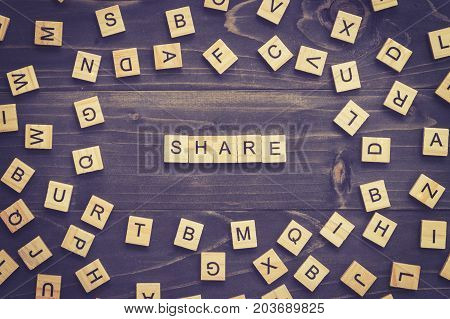 Share Word Wood Block On Table For Business Concept.