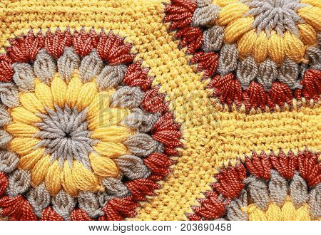 Knitted textile carpet pattern macro in yellow color