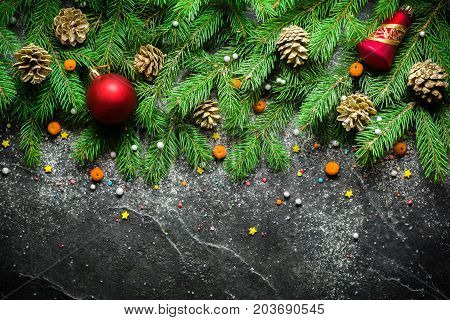 Christmas And New Year Background. Christmas Tree Branch On A Black Background. Cones And Fur-tree T