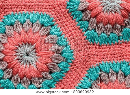 Knitted textile carpet pattern macro in pink color