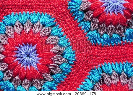 Knitted textile carpet pattern macro in pink and blue color