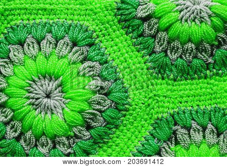 colorful green Knitted textile carpet pattern macro.