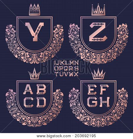 Rose gold coat of arms set in baroque style. Golden pink vintage logos with Y, Z monogram and other letters of the English alphabet.