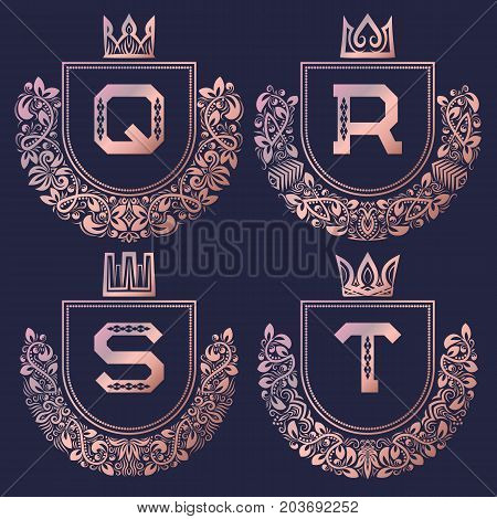 Rose gold coat of arms set in baroque style. Golden pink vintage logos with Q, R, S, T monogram.