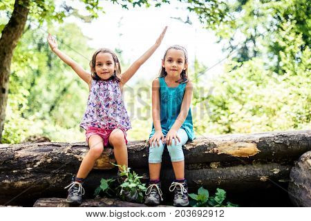 Children - Twin Girls Are Hiking In The Mountains.