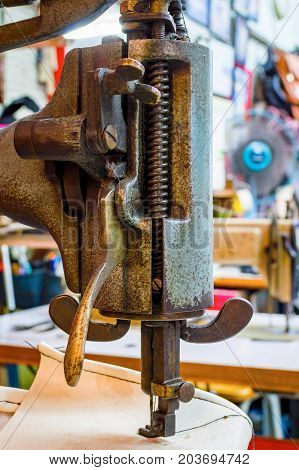 Fragment Of The Old Heavy Sewing Machine. Clothing Industry. Sewing Workshop