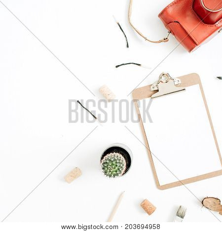 Clipboard with blank paper retro camera succulent tools for handmade arts on white background. Top view flat lay hipster artist concept.