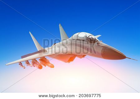 Military Fighter Against A Blue Sky With A Backlight From Below