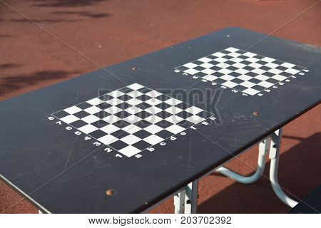 chessboard on the children's playground in courtyard of the house in Moscow, Russia