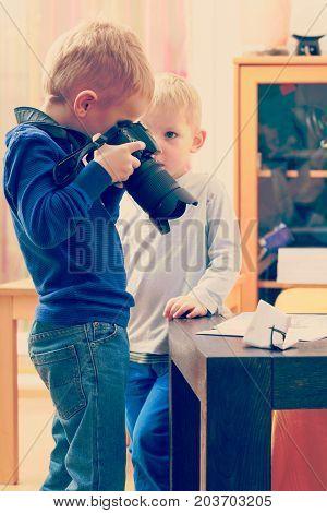 Kid Playing With Big Professional Digital Camera