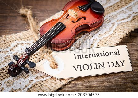 The vintage International violin day card concept.