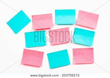 Blank post it notes or sticky note on white wall.