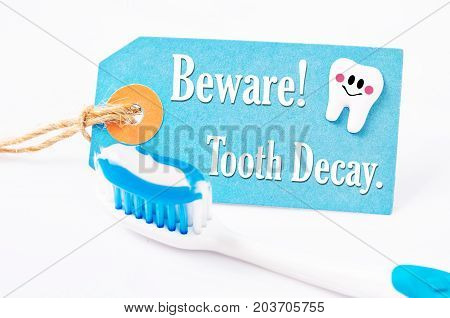 Beware tooth decay with toothpaste and toothbrush.