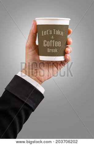 Hand of Businessman holding paper coffee cup with Let's take a coffee break text.