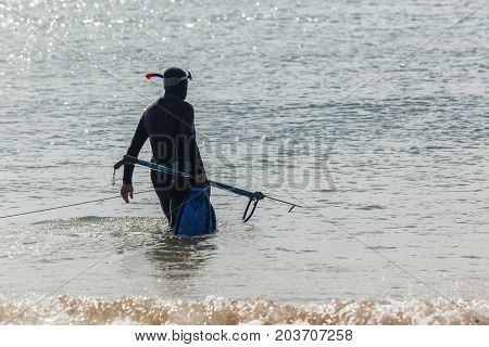 Spear Fishing Diver Beach Ocean