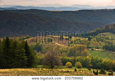Viewpoint on a landscape of mount Bobija, peaks, hills, meadows and colorful forests, west Serbia