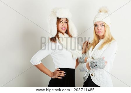Two Ladies In Winter White Outfit.