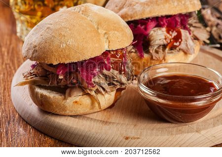 Pulled Pork Sandwich With Red Cabbage And Bbq Sauce
